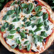 Rustic black olives and heirloom tomatoes pizza