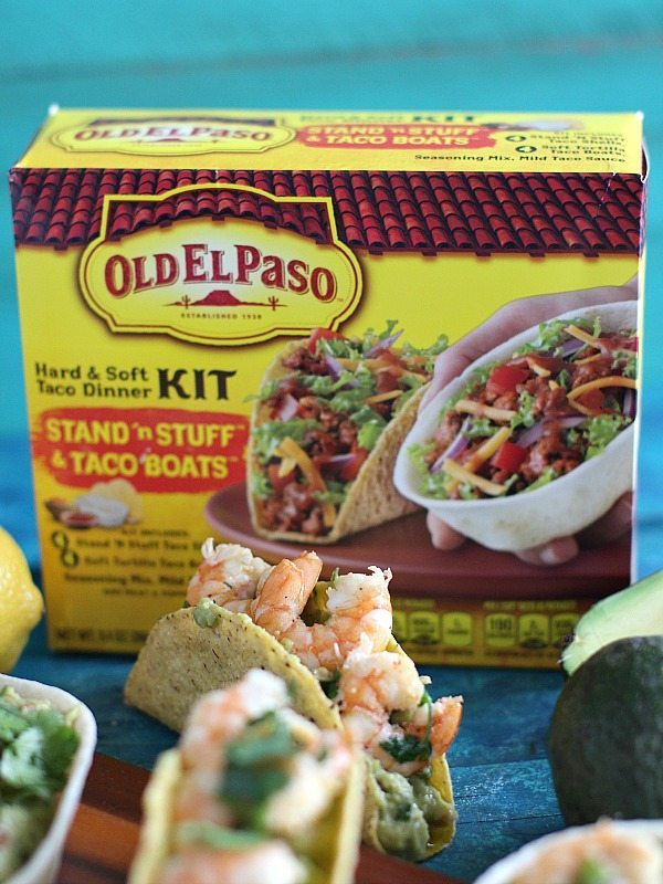 Guacamole Taco Boats loaded with creamy avocados and topped with garlicky and spicy shrimp are the perfect mess free appetizer.
