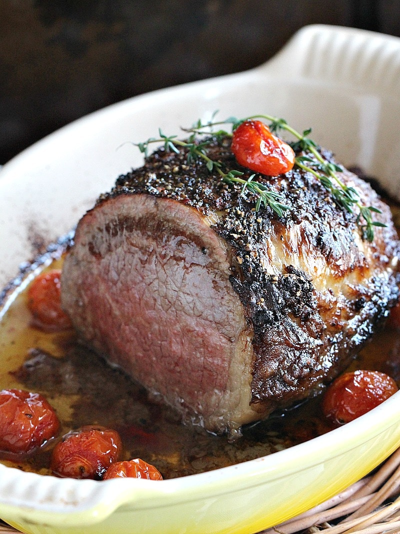 Garlic and Wine Roasted Beef Tenderloin with a peppery crust, is roasted to perfection with grape tomatoes and fresh thyme.