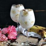 Butterscotch Banana Trifle is served in individual glasses and topped with sliced almonds for a chewy and nutty finish.