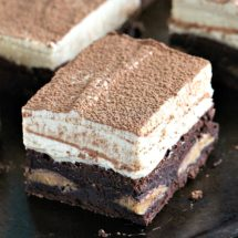 Peanut Butter Mousse Brownies are stuffed with Reese's Peanut Butter Eggs and topped with a creamy No Bake Peanut Butter Mousse. They are puffy, rich and flavorful, and very easy to make.