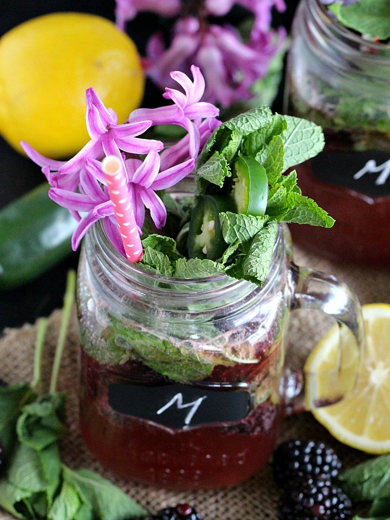 Sweet Roasted Blackberry Mojito with blackberry ice, lemon mint syrup, fresh mint and a spicy jalapeño is refreshing and stunning.