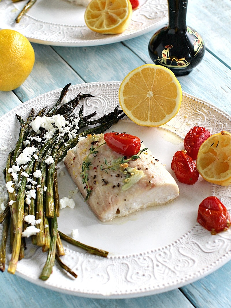 Image of roasted mahi-mahi and asparagus on a white plate.