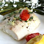 Oven Roasted Mahi Mahi in olive oil and lemon juice, served with roasted grape tomatoes and asparagus, made in just 30 minutes.