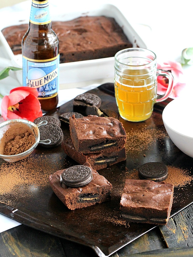 Chocolate Beer Bars are stuffed with Reese's Oreos and topped with a flavorful beer icing. One bowl, easy to make and ready in under one hour.