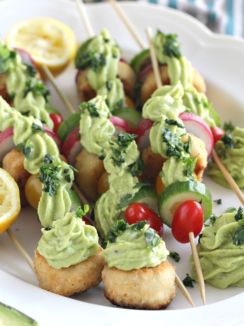 Vegan Crab Cake Veggie Skewers are fun and colorful, perfect for an appetizer or dinner, loaded with crispy veggies and topped with a creamy avocado sauce.