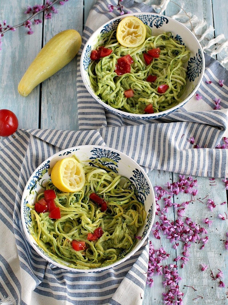 An easy dinner of zucchini noodles in spicy, creamy avocado sauce topped with lemon, peppery tilapia takes only 20 minutes to make.