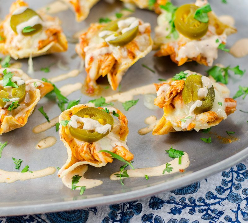 Mouth watering and hot Chipotle Chicken Nachos are cheesy, spicy, crunchy and hearty, the perfect bite for a Cinco de Mayo party.