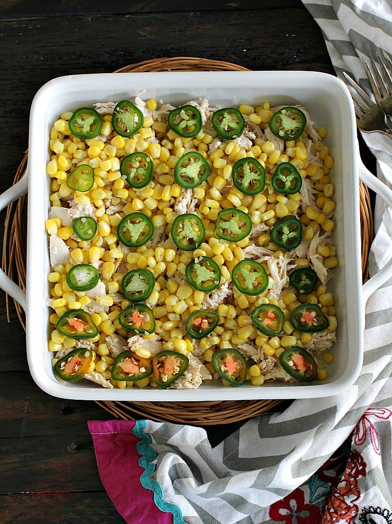 Creamy and cheesy Hash Brown Chicken Jalapeño Casserole loaded with spicy jalapeños, sweet corn, tender chicken and a delicious layer of hash browns.