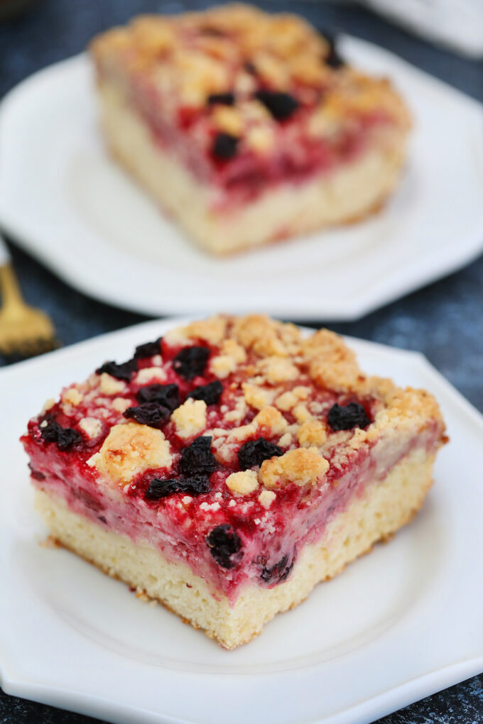 Cherry Cream Cheese Coffee Cake is made with a cake layer topped with a cheesecake filling, juicy cherries and a buttery crumb topping. #coffeecake #brunch #cherries #sweetandsavorymeals #desserts