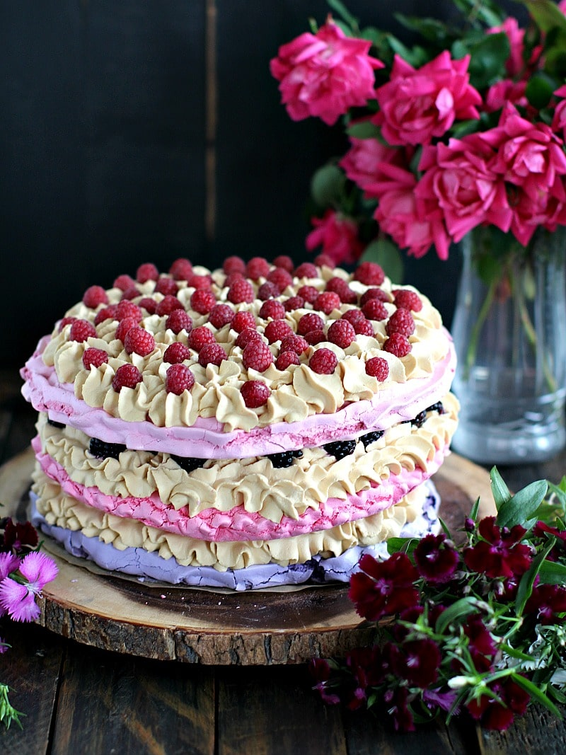Very easy to make, flourless, gluten free Naked Ombre Meringue Cake is topped with Dulce de Leche whipped cream and tart berries.