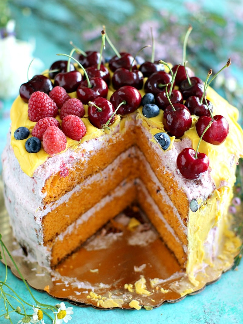 Fragrant and tender mandarin olive oil cake with fresh mandarin zest and vanilla bean seeds is covered in a sweet and delicious raspberry buttercream.