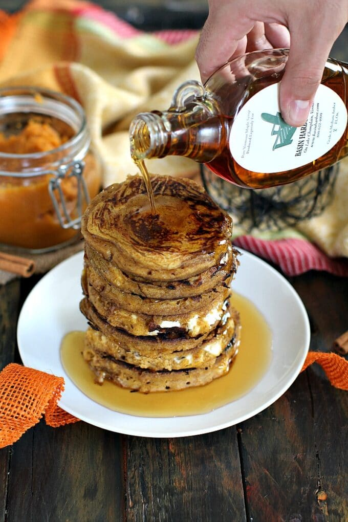 Pumpkin cheesecake pancakes topped with maple syrup