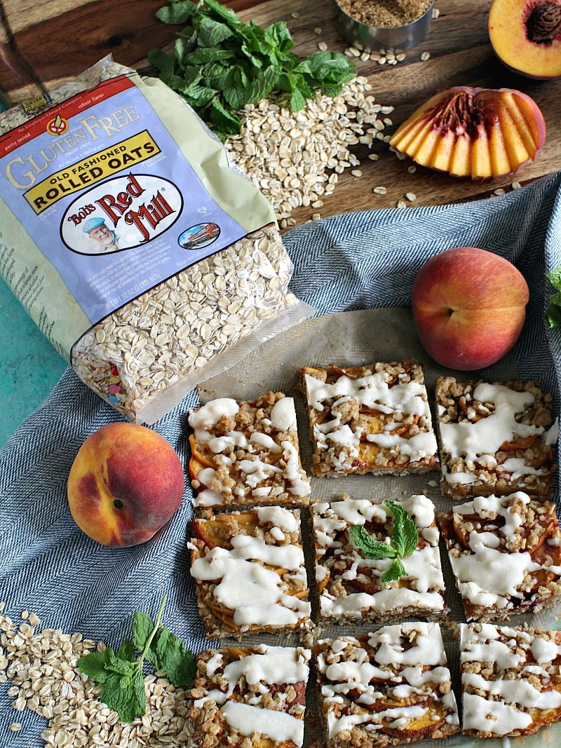 Easy to make, Gluten Free Peach Cobbler Bars are also vegan and incredibly delicious. Made with fresh peaches and gluten free oats.