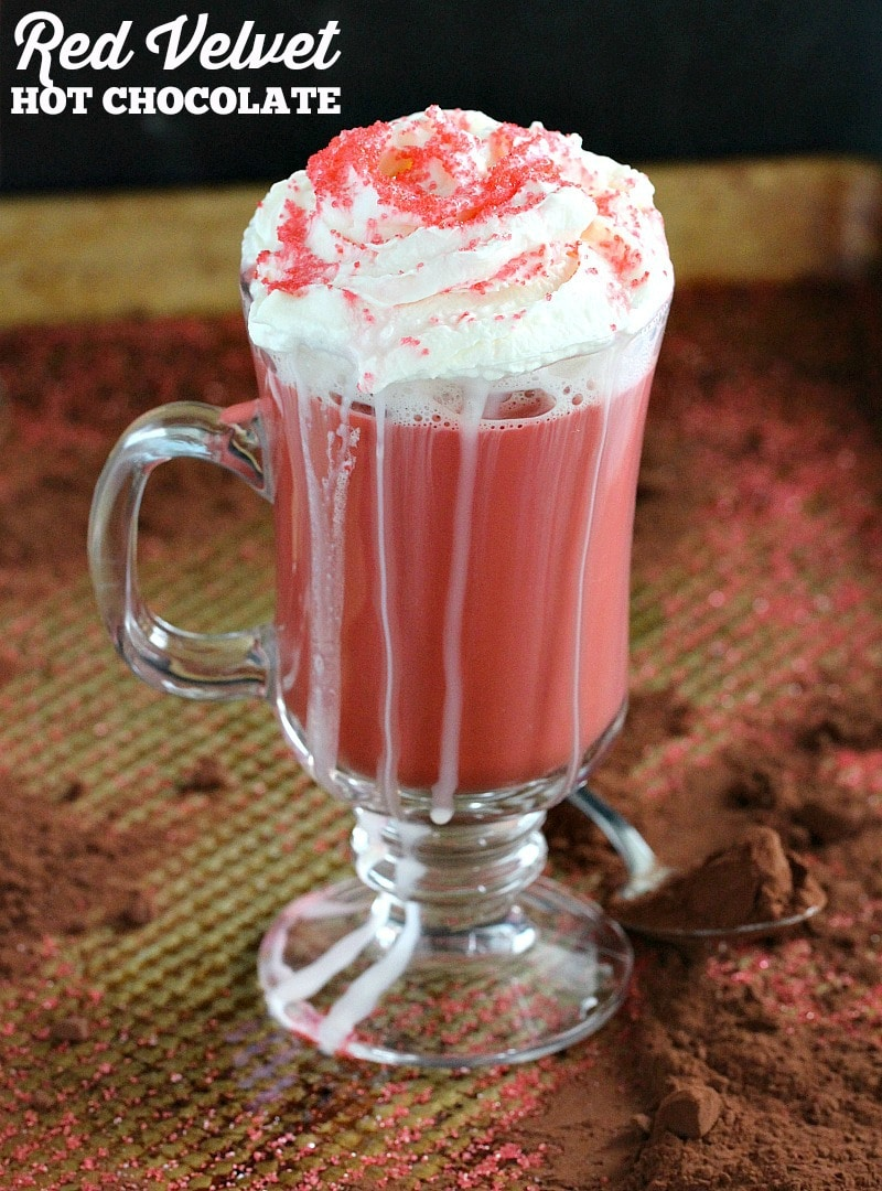 Red Velvet Hot Chocolate topped with a dollop of whipped cream is luxurious and rich and the perfect treat when signing holiday cards.
