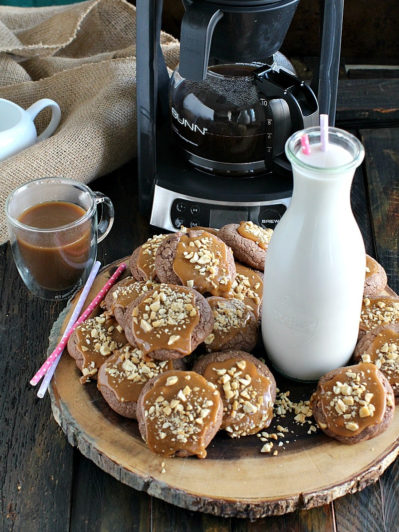 Freshly brewed coffee is served with Snickers Cookies that are loaded with salted peanuts, milk chocolate chips and topped with caramel.