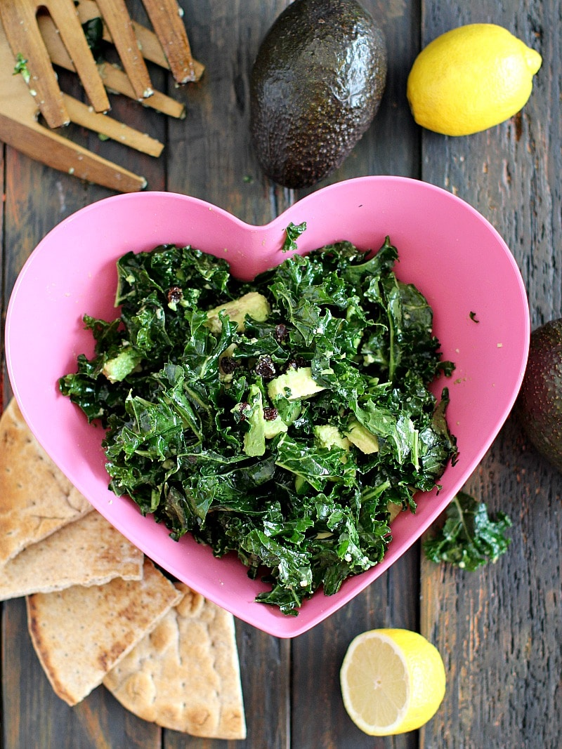 Easy and delicious, my go-to Massaged Kale Salad with creamy avocado, crunchy cucumbers and sweet raisins paired with cold-pressed green juice.