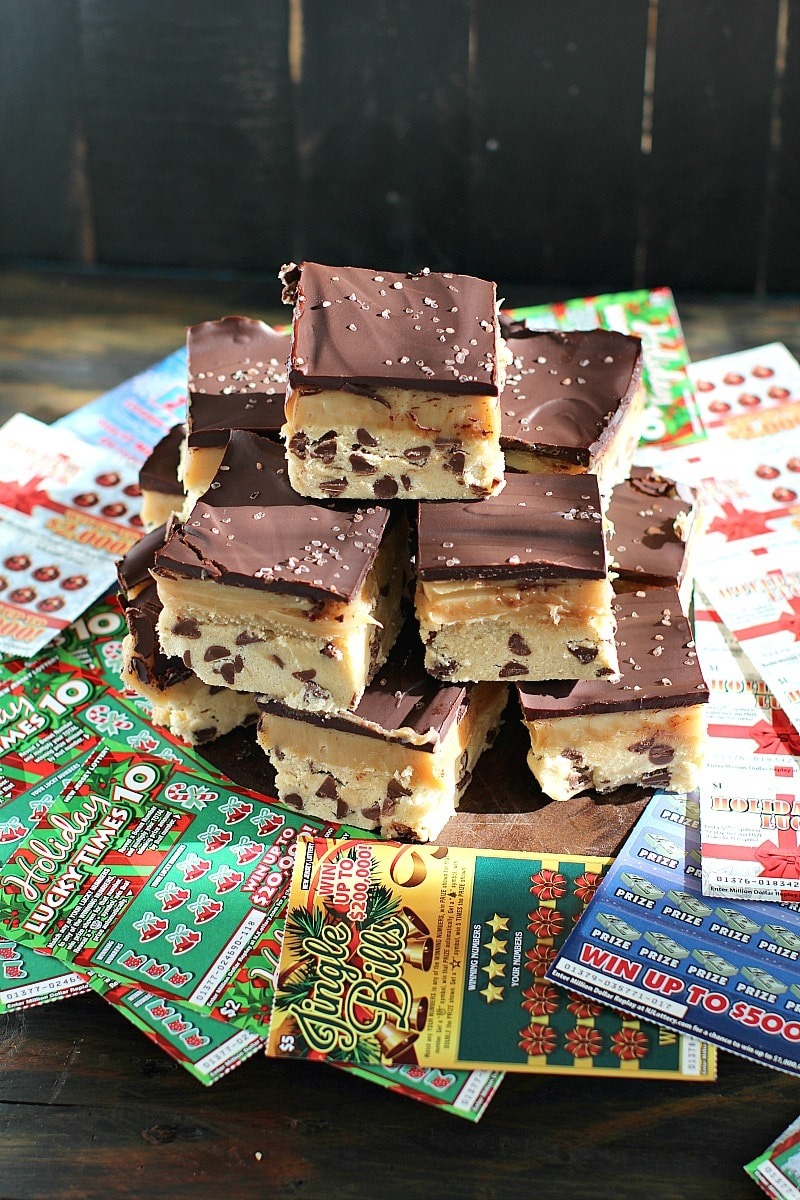 No Bake Millionaire Bars with a rich layer of cookie dough, topped with a thick caramel and finished with chocolate are the perfect treat on Lotto Night with New Jersey Lottery Holiday Games!