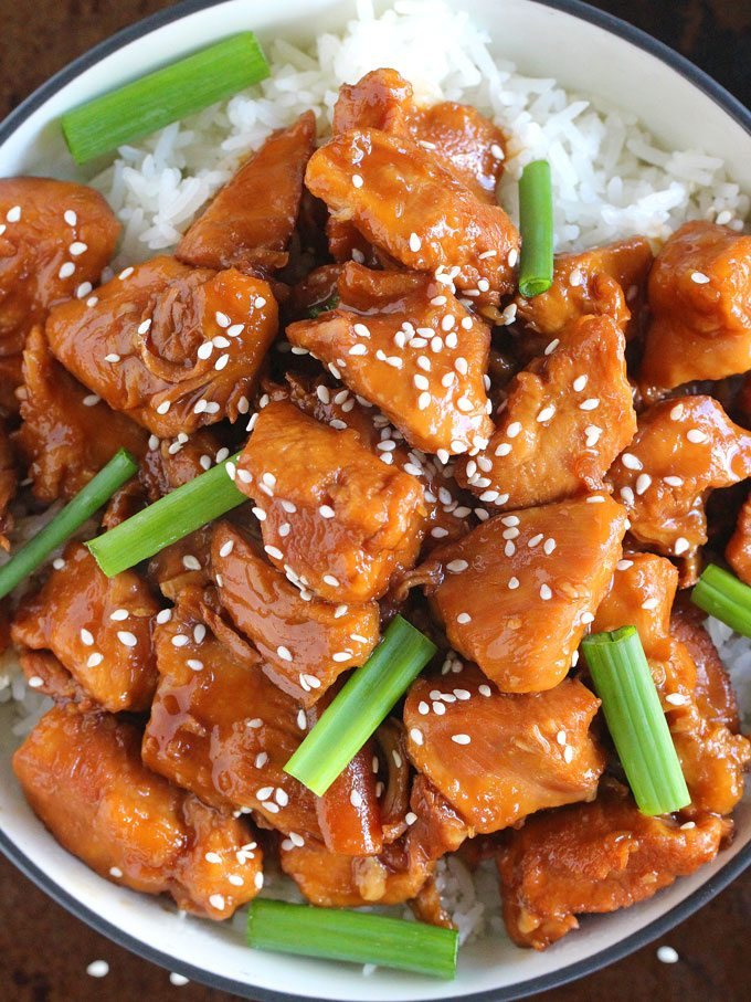 Instant pot mongolian chicken and rice garnished with sesame seeds and green onion