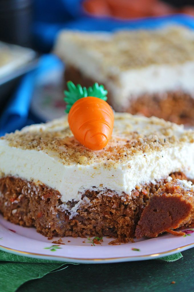 Carrot Cake Poke Cake is an incredibly easy and delicious cake made using cake mix, topped with a thick layer of mascarpone cream cheese frosting.