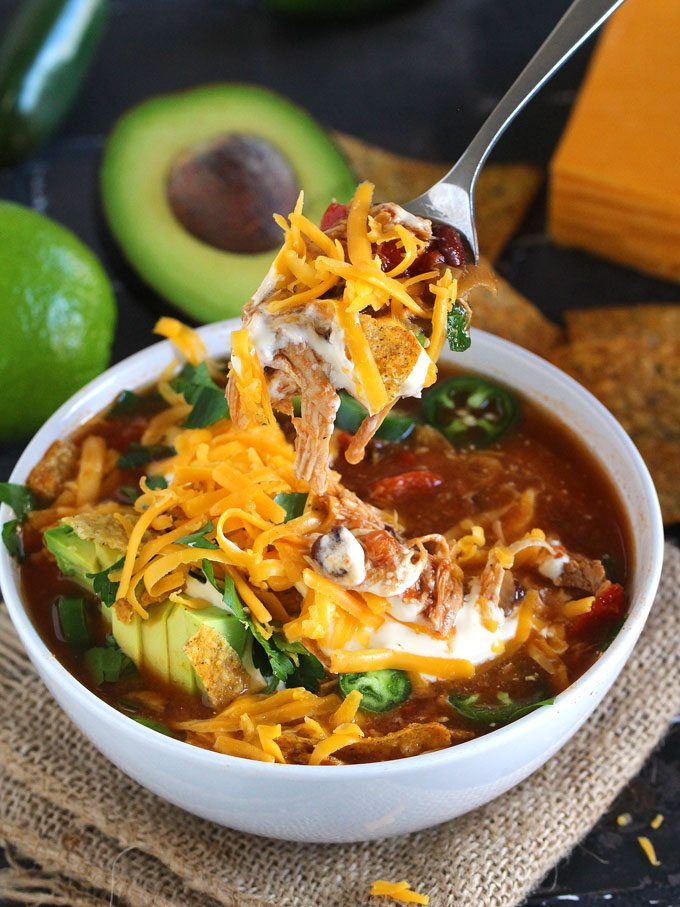Spicy, loaded with you favorite fixings, this easy to make Slow Cooker Chicken Tortilla Soup is the epitome of comfort food.