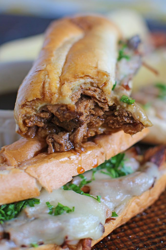 Slow Cooker French Dip Sandwiches are incredibly juicy, tender and so flavorful. Perfect for a delicious dinner and the best quick and easy party food.