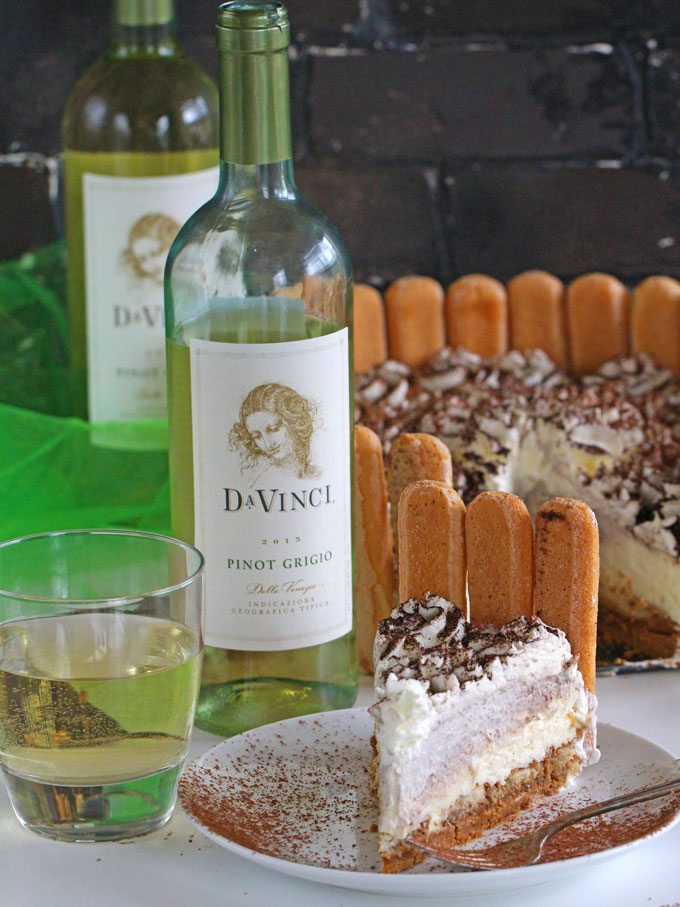 No Bake Tiramisu Cheesecake sliced and served with DaVinci Pinot Grigio.