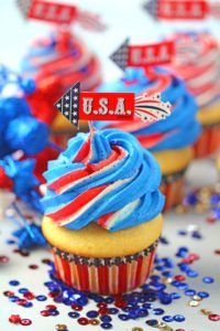 Red White and Blue Cupcakes are the perfect patriotic treat. Fluffy and soft vanilla cupcakes are topped with sweet red, white and blue buttercream swirl.