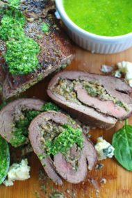 Stuffed Flank Steak with Spinach and Blue Cheese is packed with garlic, caramelized onions and walnuts.