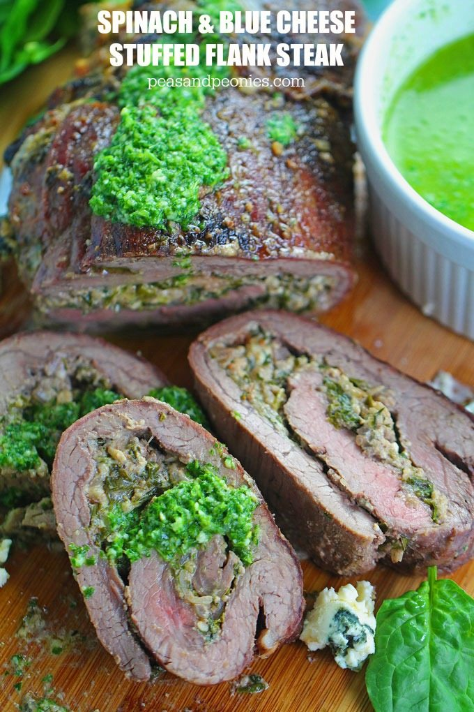 Stuffed Flank Steak with Spinach and Blue Cheese is packed with garlic, caramelized onions and walnuts. Served with chimichurri sauce!