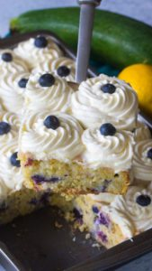 Blueberry Zucchini Poke Cake is so tender, moist and delicious. Made with zucchini, olive oil, lots of fresh lemon zest and juicy blueberries.