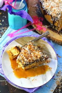 The best No Bake Coconut Cheesecake is so creamy and indulgent. Topped with chocolate ganache, lots of toasted coconut and finished with caramel sauce.