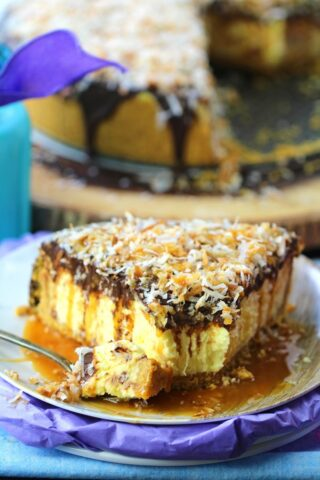 No Bake Coconut Cheesecake is so creamy and indulgent. Topped with chocolate ganache, lots of toasted coconut and finished with caramel sauce.