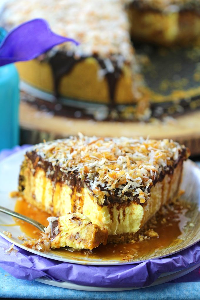 No Bake Samoa Cheesecake is so creamy and indulgent. Topped with chocolate ganache, lots of toasted coconut and finished with caramel sauce.