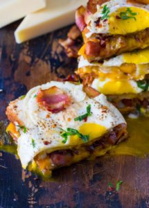 The ultimate Monte Cristo Grilled Cheese sandwiches are deliciously stuffed with fried ham, bacon, cheese and topped with a perfect runny egg.