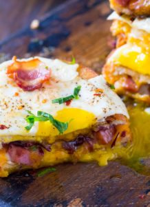 Monte Cristo Grilled Cheese sandwiches are stuffed with fried ham, bacon, cheese and topped with a perfect runny egg.