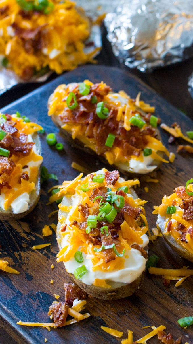 Slow Cooker Baked Potatoes are the perfect side dish that you can make in your slow cooker year around. Seriously, its the easiest recipe ever!