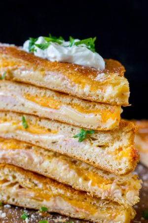 Turkey Grilled Cheese made easy to cook in a large batch using crescent dough sheets. Delicious and fit to feed a crowd with minimum effort!