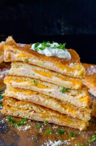 Baked Turkey Grilled Cheese sandwiches made easy to cook in a large batch using crescent dough sheets. Delicious and fit to feed a crowd with minimum effort!