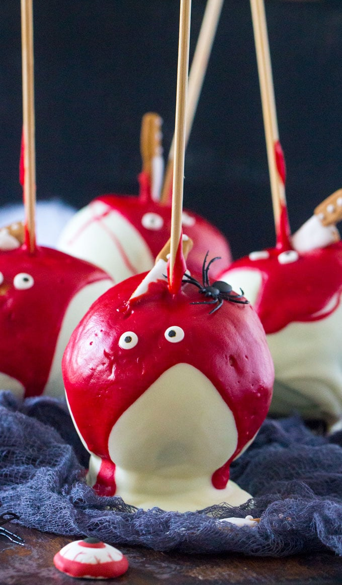 Bloody Halloween Desserts like these Chocolate Dipped Apples, are a fun and easy way to take your Halloween treats to a new scary, delicious and fun level!