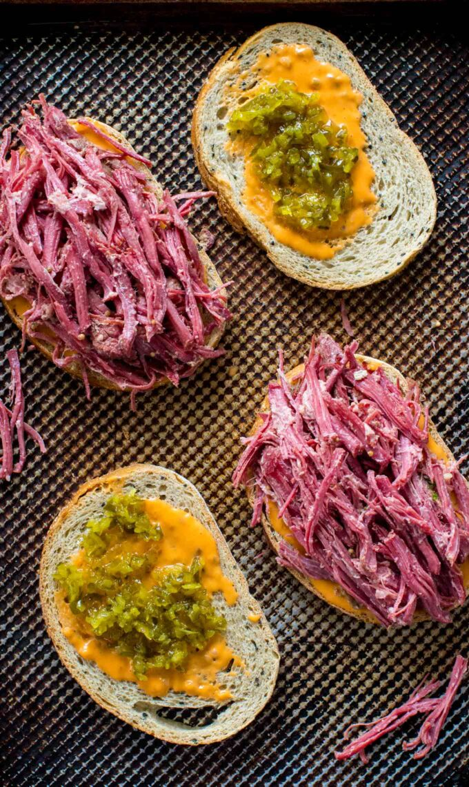 Image of corned beef sandwiches with mustard.