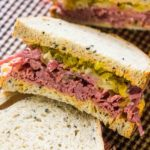 The real deal Corned Beef Sandwiches are the homemade take on the classic deli sandwiches of corned beef with toasted rye bread, sauerkraut and Russian dressing.