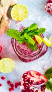 Pretty Pomegranate Mojito made with fresh ginger is the perfect fall drink. With a gorgeous color and a sweet, refreshing taste, this will become your go to drink.