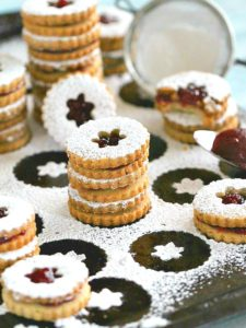Eggless Walnut Raspberry Linzer Cookies are tender, buttery and sweet. They melt in your mouth and have a light nutty flavor and a delicious raspberry preserves middle.