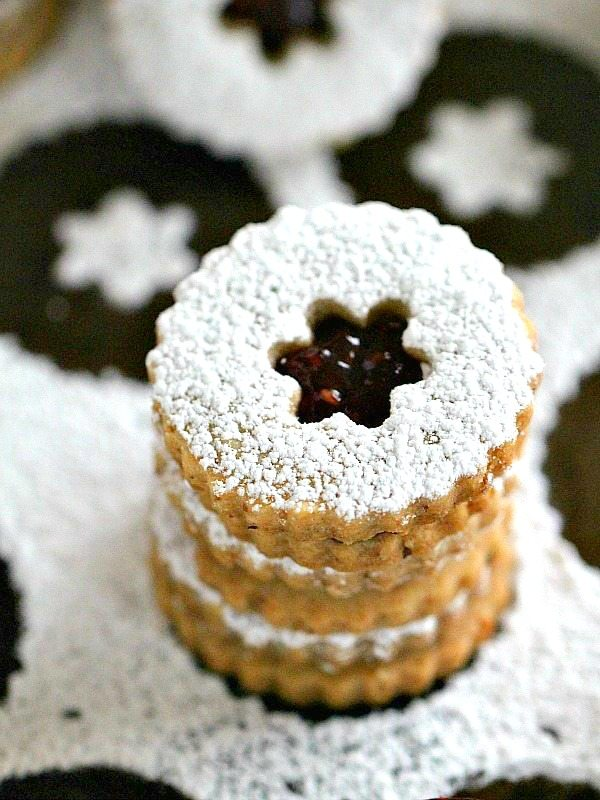 Best Walnut Raspberry Linzer Cookies are tender, buttery and sweet. They melt in your mouth and have a light nutty flavor and a delicious raspberry preserves middle.