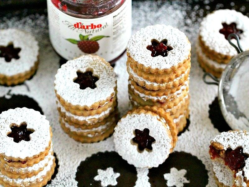 Linzer Cookies are tender, buttery and sweet. They melt in your mouth and have a light nutty flavor and a delicious raspberry preserves middle.