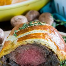 Beef Wellington cooked perfectly while wrapped in puff pastry, ham and the most amazing mushroom duxelles made with cognac duck mousse.
