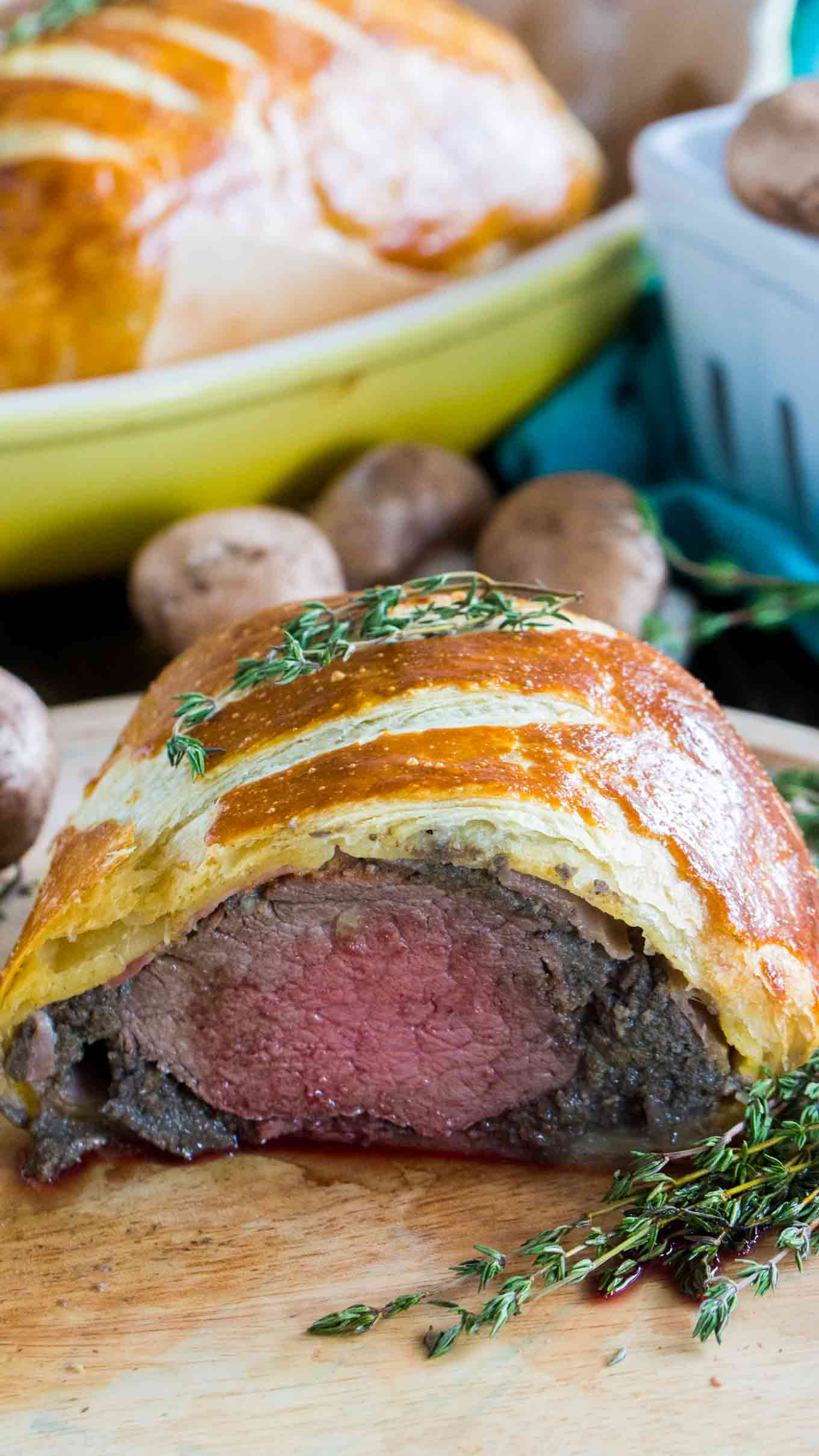 Beef Wellington cooked perfectly while wrapped in puff pastry, ham and the most amazing mushroom duxelles made with cognac duck liver mousse pate.
