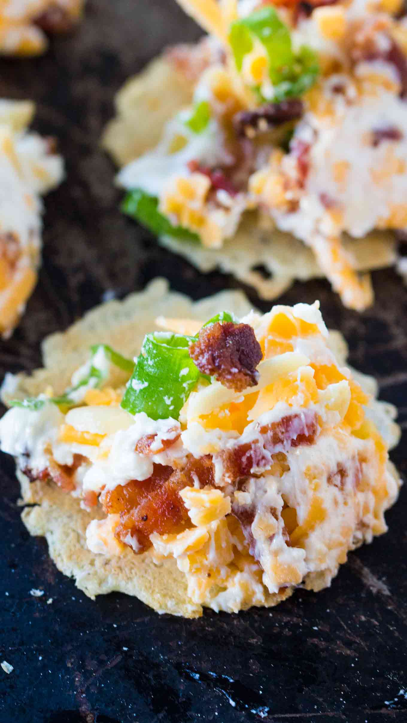 Best Million Dollar Dip is the best cheese dip that you can make! Layers of creamy cheese, sharp cheddar cheese, bacon, slivered almonds and green onions!