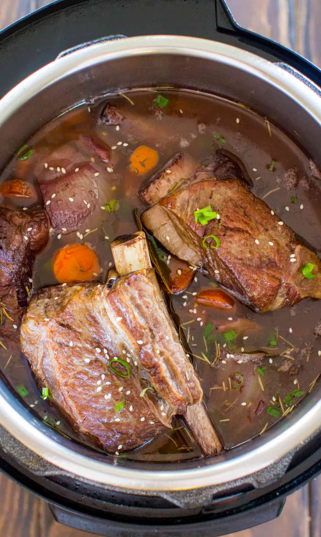 Easy Instant Pot Short Ribs are juicy and fall of the bone, cooked in the most amazing garlic and wine sauce, and ready to eat in just 2 hours!